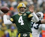 Green Bay Packers quarterback Brett Favre drops back to pass during the first half of an NFL football game against the Carolina Panthers Sunday, Sept. 18, 2007, in Green Bay, Wis. (AP Photo/Morry Gash)